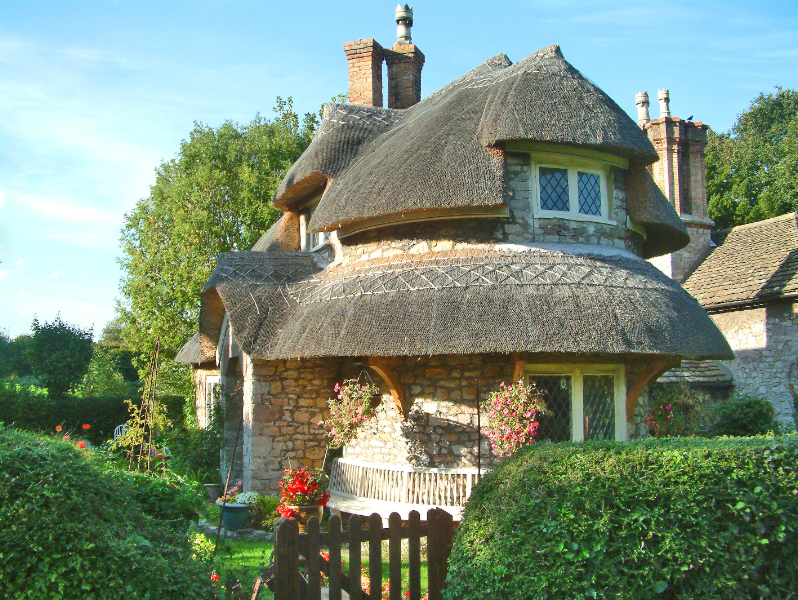 Cottage homes rounded thatched roof4
